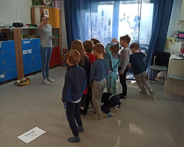 Children learn English during a Moomin Language School playful lesson.