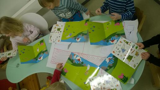 Children playing with Moomin Language School sticker cards