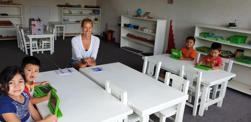 Romy in a schoolroom with Guatemalan children