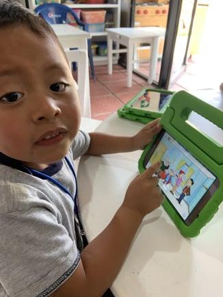 A boy using MoominLS in Guatemala