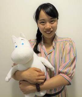 Wako holding a Moomin toy