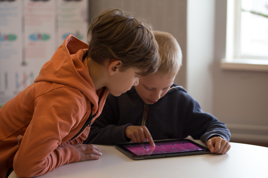 Two kids using a tablet
