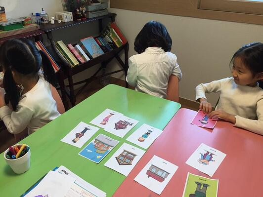 Children playing with picture cards