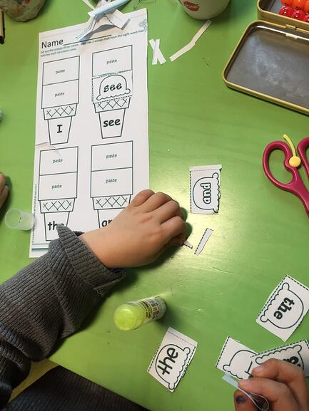 A child engaging in language learning activities