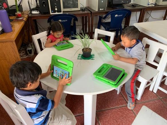 Children using MoominLS in Guatemala