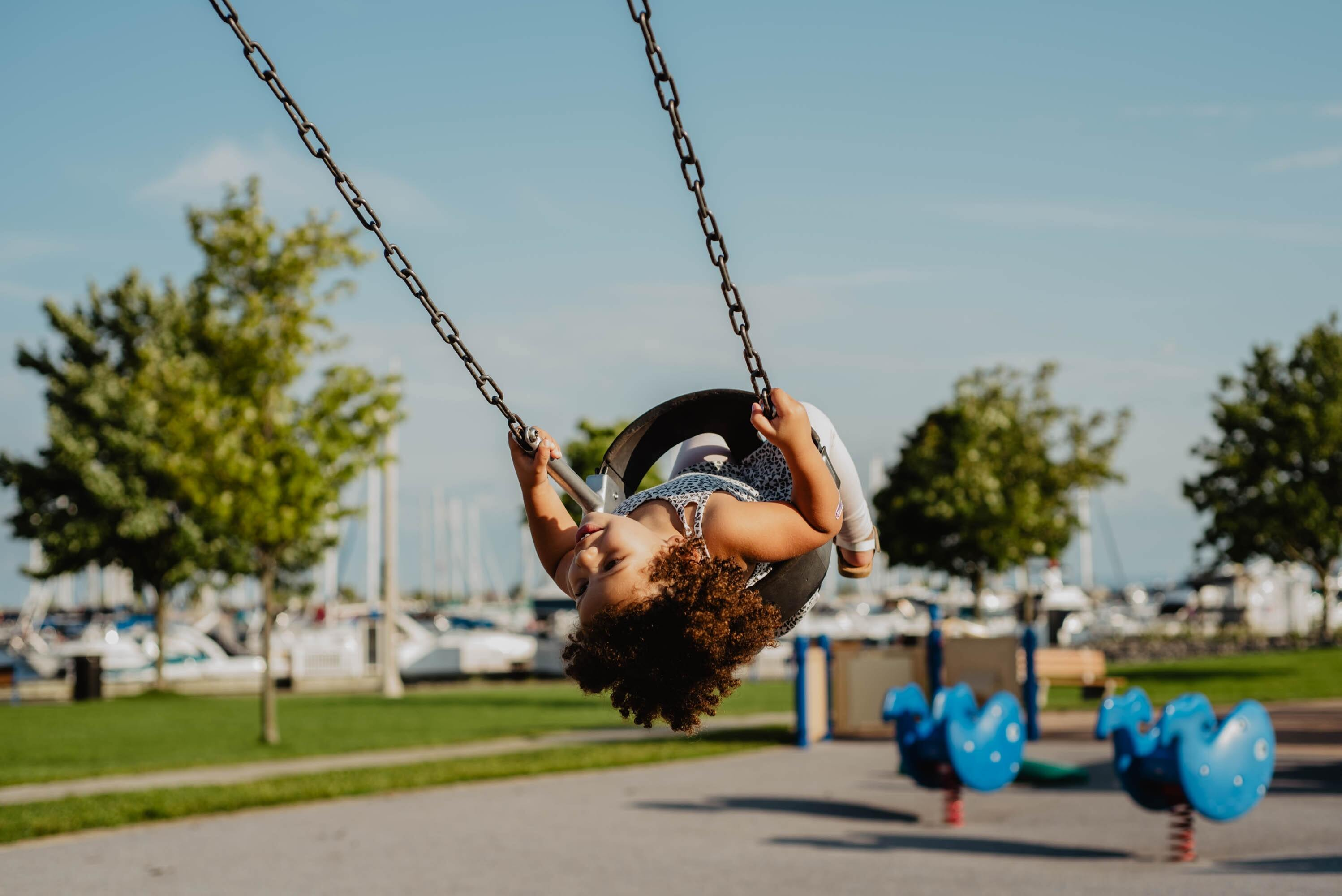 a child on a tire swing